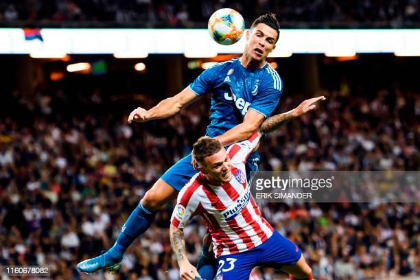 TOPSHOT Juventus' Cristiano Ronaldo heads the ball over Atletico Madrid's Kieran Trippier during the International Champions Cup football match...