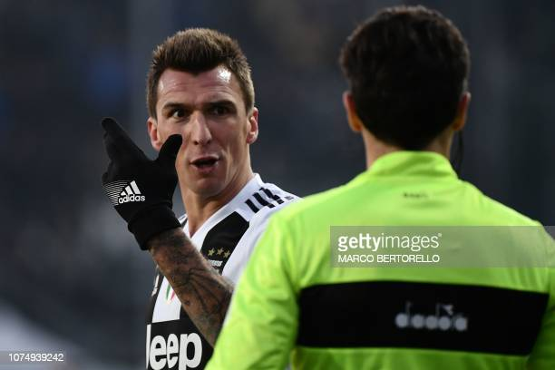 Juventus' Croatian forward Mario Mandzukic argues with the referee during the Italian Serie A football Match Atalanta Bergamo vs Juventus on December...