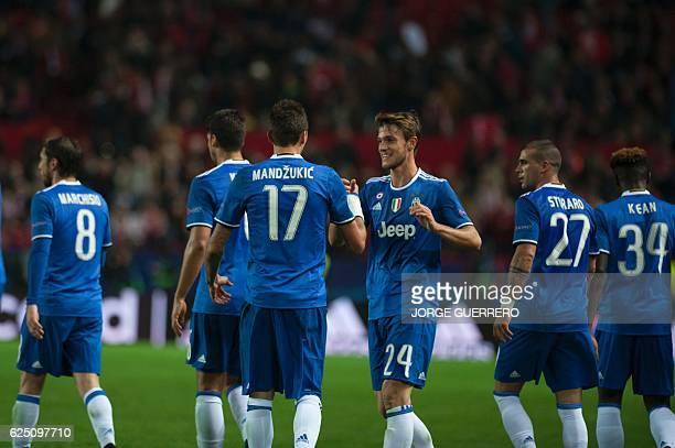 Juventus' Croatian forward Mario Mandzukic celebrates a goal with teammates during the UEFA Champions League football match Sevilla FC vs Juventus at...