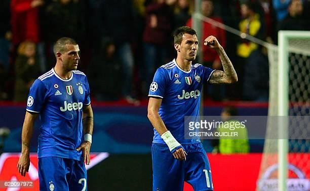 Juventus' Croatian forward Mario Mandzukic celebrates after scoring a goal during the UEFA Champions League football match Sporting CP vs Real Madrid...