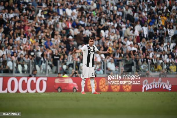 Juventus' Croatian forward Mario Mandzukic celebrates after scoring an equalizer during the Italian Serie A football match Juventus vs Napoli on...