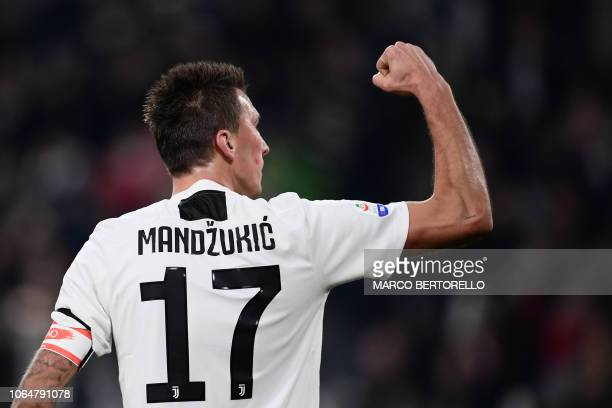 Juventus' Croatian forward Mario Mandzukic celebrates after scoring during the Italian Serie A football match Juventus vs Spal 2013 on November 24...