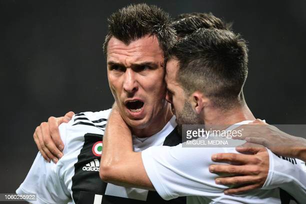 Juventus' Croatian forward Mario Mandzukic celebrates with Juventus' Bosnian midfielder Miralem Pjanic after opening the scoring scoring during the...