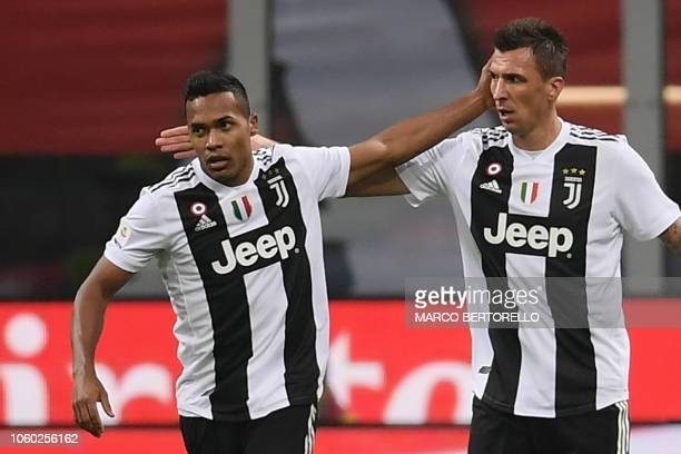 Juventus' Croatian forward Mario Mandzukic celebrates with Juventus' Brazilian defender Alex Sandro after opening the scoring scoring during the...