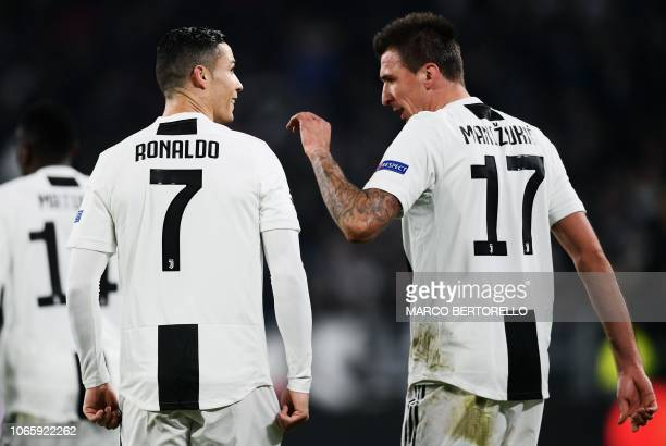 Juventus' Croatian forward Mario Mandzukic celebrates with Juventus' Portuguese forward Cristiano Ronaldo after opening the scoring during the UEFA...