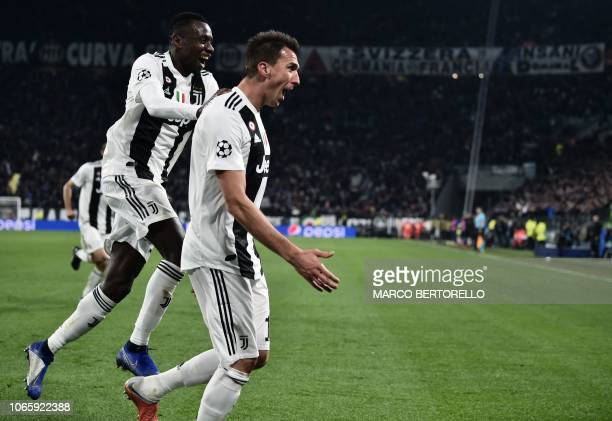 Juventus' Croatian forward Mario Mandzukic celebrates with Juventus' French midfielder Blaise Matuidi after opening the scoring during the UEFA...