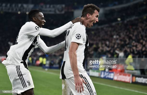 TOPSHOT Juventus' Croatian forward Mario Mandzukic celebrates with Juventus' French midfielder Blaise Matuidi after opening the scoring during the...
