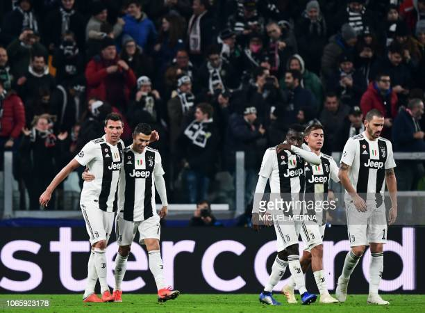 Juventus' Croatian forward Mario Mandzukic celebrates with Juventus' Portuguese forward Cristiano Ronaldo celebrates after opening the scoring as...