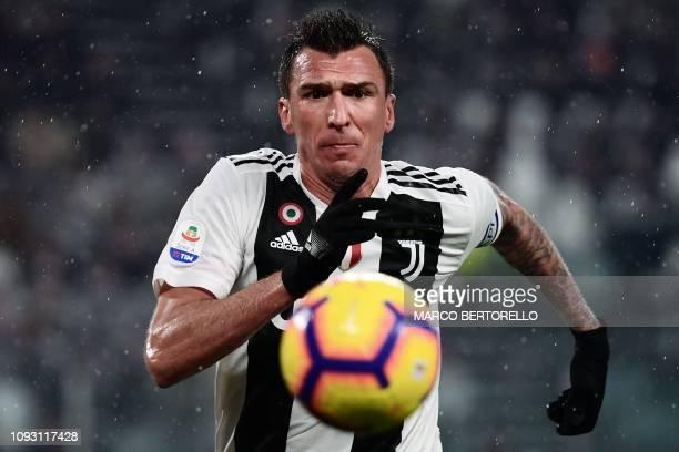 Juventus' Croatian forward Mario Mandzukic eyes the ball during the Italian Serie A football match Juventus vs Parma on February 2, 2019 at the...