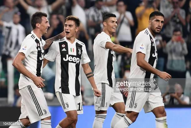 Juventus' Croatian forward Mario Mandzukic Juventus' Argentine forward Paulo Dybala Juventus' Portuguese forward Cristiano Ronaldo and Juventus'...