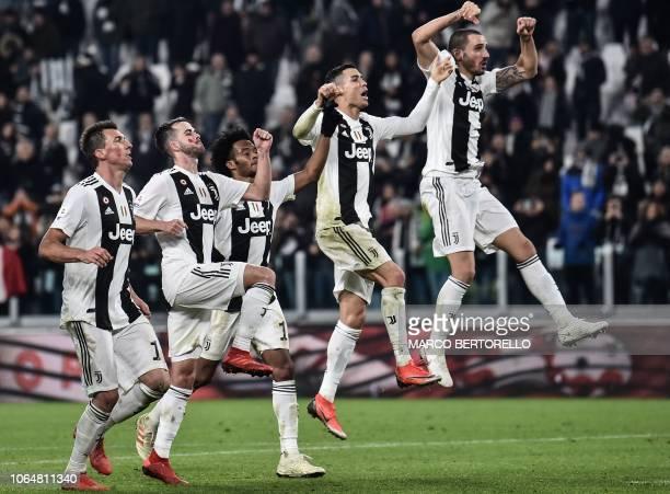Juventus' Croatian forward Mario Mandzukic Juventus' Bosnian midfielder Miralem Pjanic Juventus' Colombian midfielder Juan Cuadrado Juventus'...