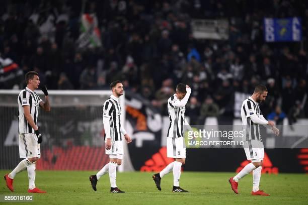 Juventus' Croatian forward Mario Mandzukic Juventus' defender Mattia De Sciglio Juventus' midfielder Rodrigo Bentancur from Uruguay and Juventus'...