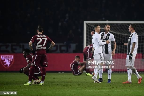 Juventus' Croatian forward Mario Mandzukic, Juventus' Italian defender Leonardo Bonucci and Juventus' Portuguese forward Cristiano Ronaldo celebrate...