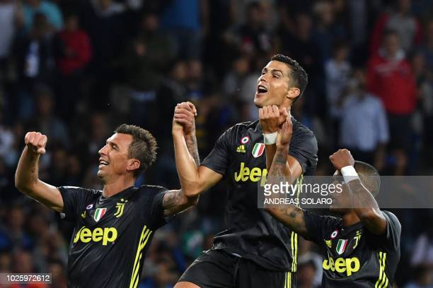 Juventus' Croatian forward Mario Mandzukic Juventus' Portuguese forward Cristiano Ronaldo and Juventus' Brazilian forward Douglas Costa celebrate...