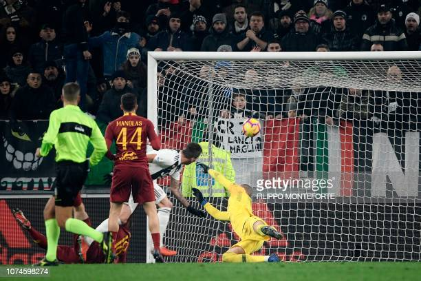 Juventus' Croatian forward Mario Mandzukic opens the scoring past AS Roma Swedish goalkeeper Robin Olsen during the Italian Serie A Football match...