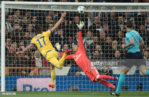 TOPSHOT Juventus' Croatian forward Mario Mandzukic scores a goal during the UEFA Champions League quarterfinal second leg football match between Real...