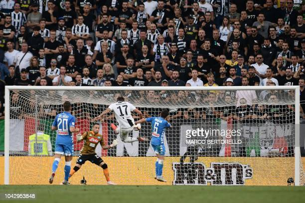 Juventus' Croatian forward Mario Mandzukic scores a header past Napoli's Colombian goalkeeper David Ospina during the Italian Serie A football match...