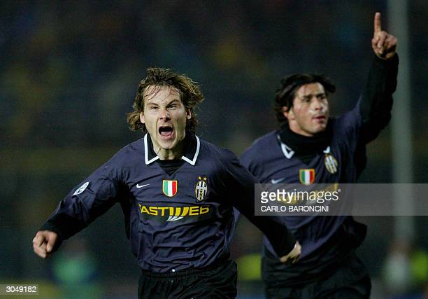 Juventus Czech midfielder Pavel Nedved celebrates with teammate Alessio Tacchinardi after scoring the third goal against Brescia in a Serie A match...