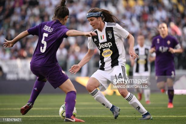 Juventus' Danish midfielder Sofie Junge Pedersen challenges Fiorentina's Italian defender Alice Tortelli during the Women's Serie A football match...