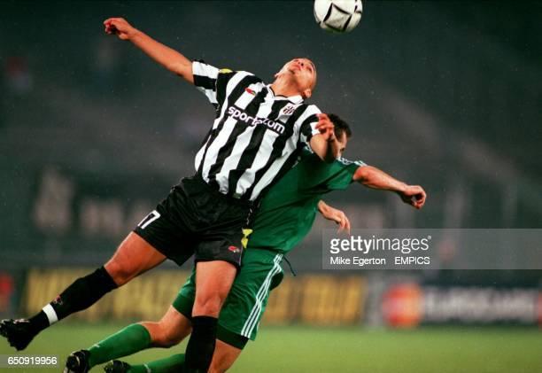Juventus' David Trezeguet jumps with Panathinaikos' Ioannis Goumas