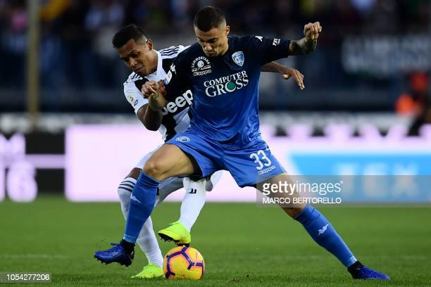 Juventus' defender Alex Sandro from Brazil fights for the ball with Empoli's midfielder Rade Krunic from Bosnia Herzegovina during the Italian Serie...