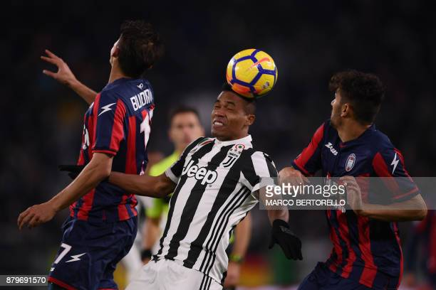 Juventus' defender Alex Sandro from Brazil heads the ball next to Crotone's forward Ante Budimir from Croatia during the Italian Serie A football...