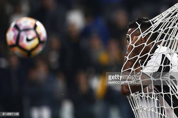 TOPSHOT Juventus' defender Alex Sandro from Brazil reacts during the Italian Serie A football match Juventus vs Udinese on October 15 2016 at the...