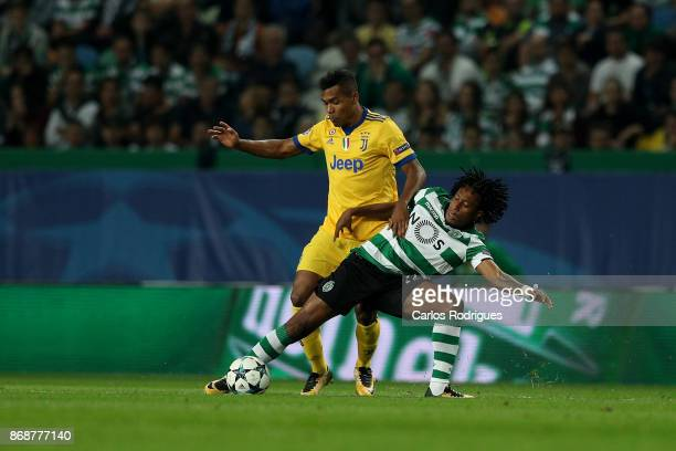 Juventus defender Alex Sandro from Brazil vies with Sporting CP forward Gelson Martins from Portugal for the ball possession during the UEFA...