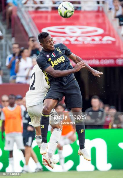 Juventus defender Alex Sandro heads away from Real Madrid defender Daniel Carvajal during an International Champions Cup match between Juventus and...
