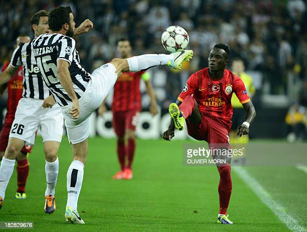 Juventus' defender Andrea Barzagli fights for the ball with Galatasaray's Portuguese midfielder Bruma during their group B Champions League football...