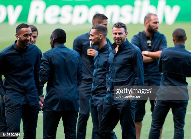 Juventus' defender Andrea Barzagli smiles next to teammates as they visit the pitch of the Camp Nou stadium in Barcelona on September 11 2017 on the...