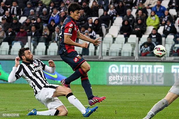 Juventus defender Andrea Barzagli tackles Genoa forward Diego Perotti during the Serie A football match n28 JUVENTUS GENOA on 22/03/15 at the...