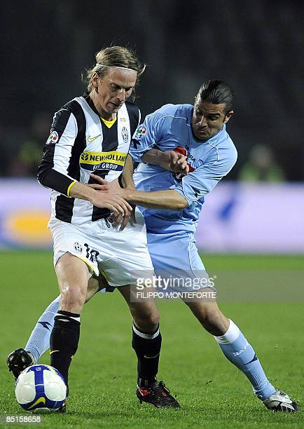 Juventus defender Christian Poulsen fights for the ball with Napoli's midfielder Manuele Blasi during their Serie A football match at Turin's Olympic...