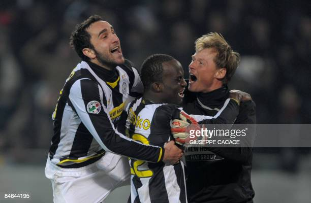 Juventus defender Cristian Molinaro and French midfielder Mohamed Lamine Sissoko celebrate with Swiss goalkeeper Alexander Manninger at the end of...