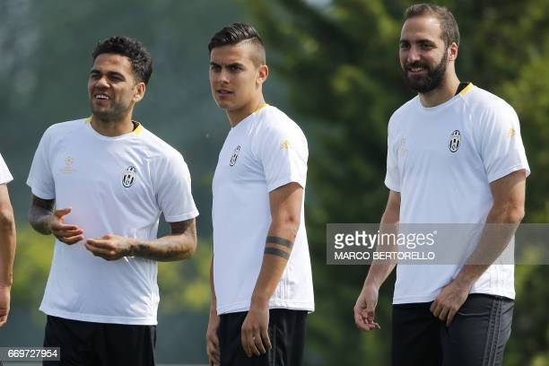 Juventus' defender Daniel Alves from Brazil Juventus' forward Paulo Dybala from Argentina and Juventus' forward Gonzalo Higuain from Argentina take...