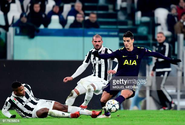 Juventus' defender from Brazil Alex Sandro and teammate Juventus' midfielder from Italy Stefano Sturaro fight for the ball with Tottenham Hotspur's...