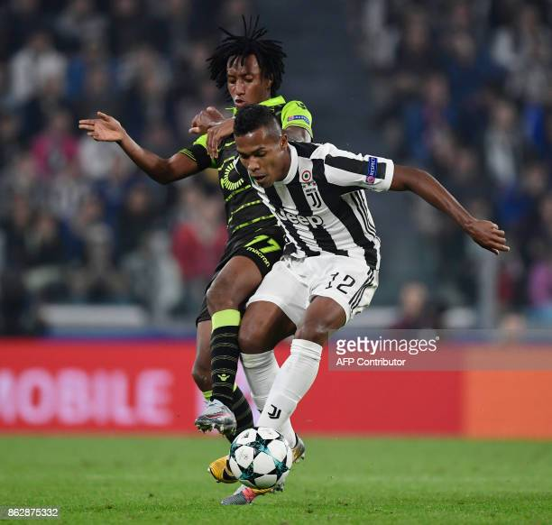 Juventus' defender from Brazil Alex Sandro fights for the ball with Sporting's forward Gelson Martins during the UEFA Champions League Group D...