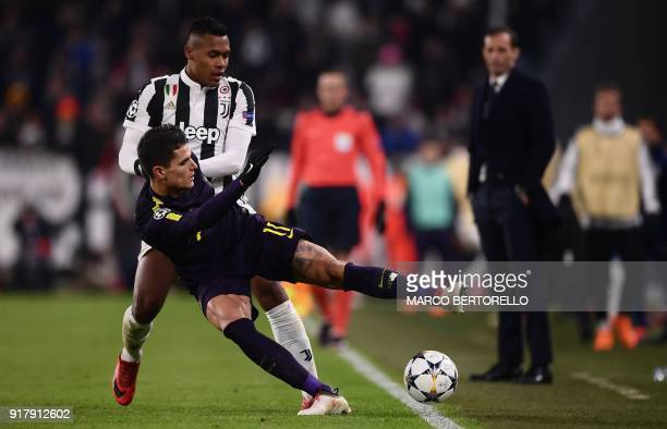 Juventus' defender from Brazil Alex Sandro fights for the ball with Tottenham Hotspur's Argentinian midfielder Erik Lamela during the UEFA Champions...