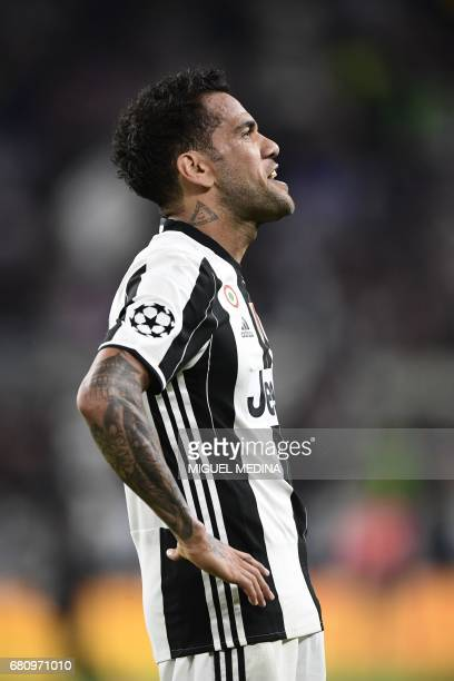 Juventus Defender from Brazil Dani Alves celebrates after scoring during the UEFA Champions League semi final second leg football match Juventus vs...