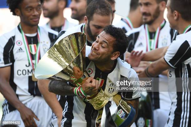 Juventus Defender from Brazil Dani Alves celebrates with the trophy after winning the Italian Serie A football match Juventus vs Crotone and the...