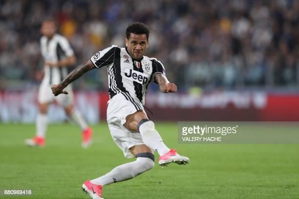 Juventus Defender from Brazil Dani Alves kicks to score during the UEFA Champions League semi final second leg football match Juventus vs Monaco on...