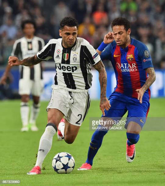 Juventus Defender from Brazil Dani Alves vies with Barcelona's Brazilian forward Neymar during the UEFA Champions League quarter final first leg...