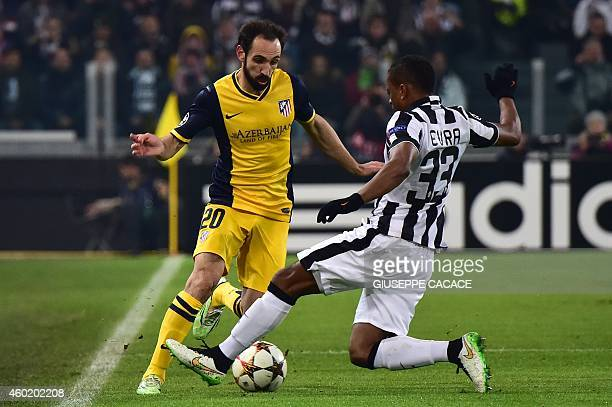 Juventus' defender from France Patrice Evra fights for the ball with Atletico Madrid's defender Juanfran during the UEFA Champions League football...