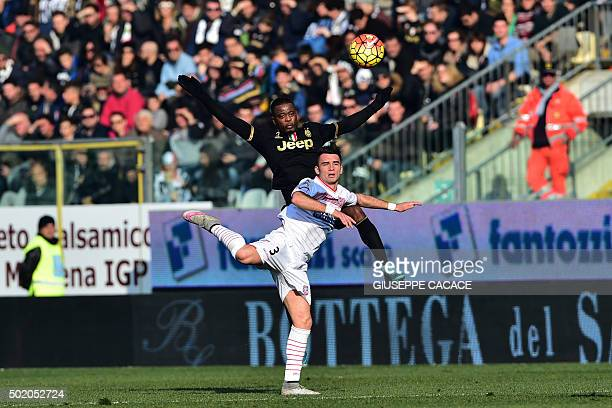 Juventus' defender from France Patrice Evra fights for the ball with Carpi's defender from Italy Gaetano Letizia during the Italian Serie A football...