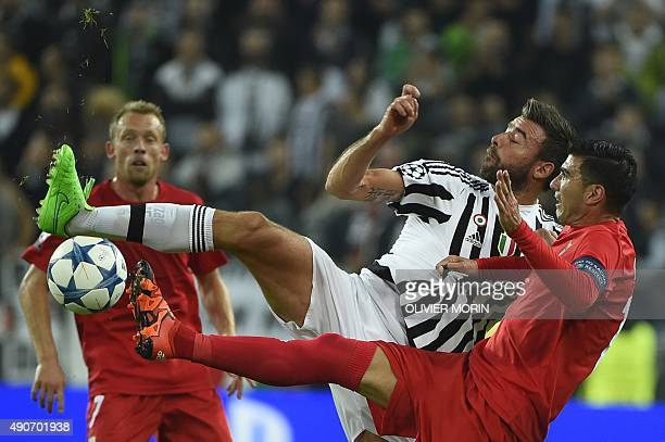 Juventus' defender from Italy Andrea Barzagli fights for the ball with Sevilla's Spanish forward Jose Antonio Reyes during the UEFA Champions League...
