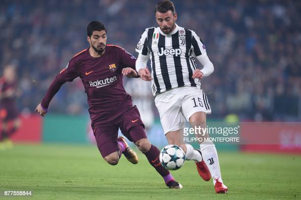 Juventus' defender from Italy Andrea Barzagli vies with Barcelona's Uruguayan forward Luis Suarez during the UEFA Champions League Group D football...