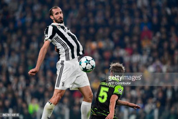 Juventus' defender from Italy Giorgio Chiellini controls the ball next to Sporting's midfielder Fabio Coentrao during the UEFA Champions League Group...