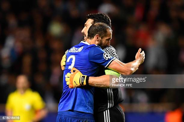 Juventus' defender from Italy Giorgio Chiellini hugs Juventus' goalkeeper from Italy Gianluigi Buffon after their 20 win over Monaco in the UEFA...