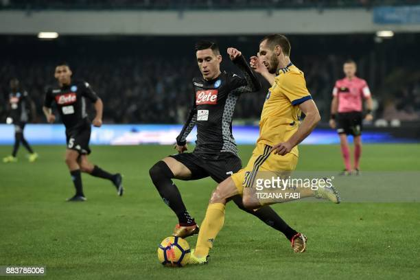 Juventus' defender from Italy Giorgio Chiellini vies with Napoli's midfielder from Spain Jose Maria Callejon during the Italian Serie A football...