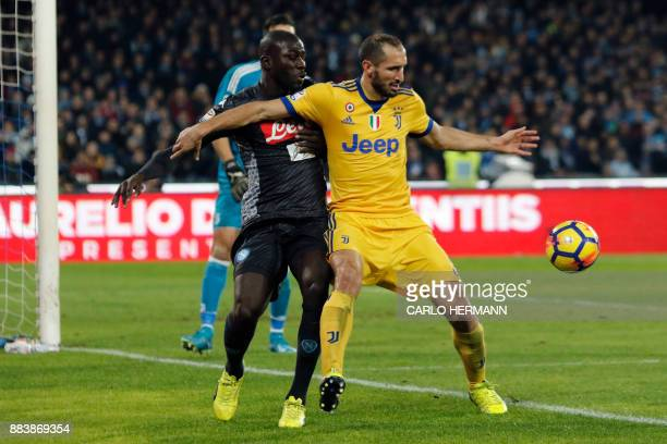 Juventus' defender from Italy Giorgio Chiellini vies with Napoli's defender from France Kalidou Koulibaly during Italian Serie A football match...